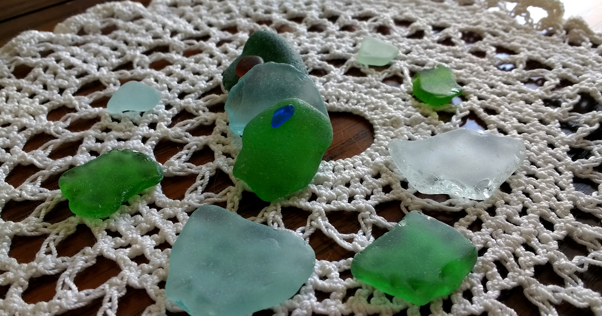 Sea glass in blue, green, and clear shades.